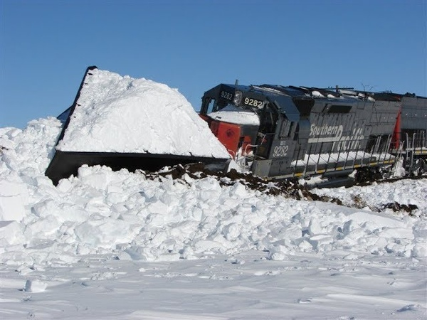 Trains Plowing Snow ! - Amazing Video.