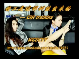 2 Chinese women tickling each other